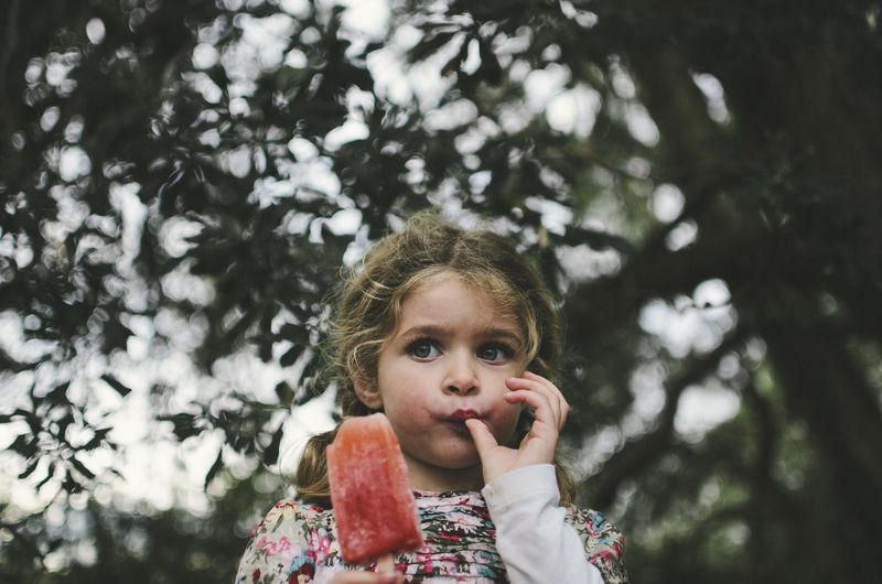 Portrait of cute girl in tree