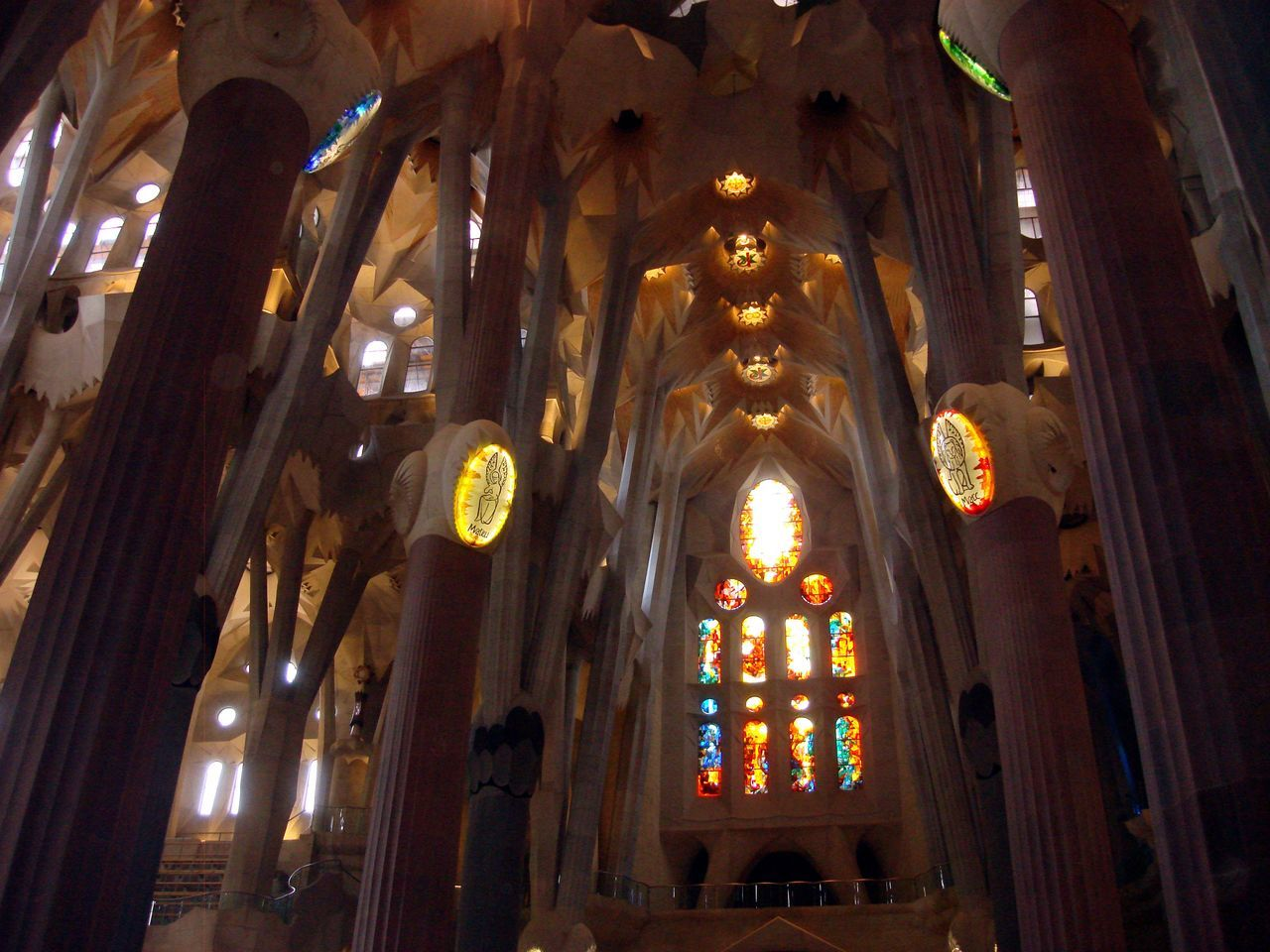 religion, low angle view, place of worship, indoors, spirituality, ceiling, architecture, built structure, illuminated, no people, hanging, day