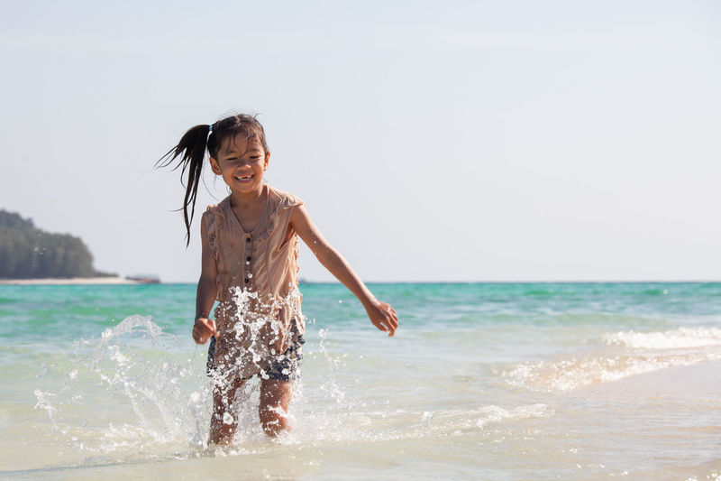 Cute asian child girl having fun to play and run on beach near the beautiful sea in summer vacation Activity Adorable Asian  Beach Beauty In Nature Brother & Sister Cheerful Child Cute Daughter Enjoying Life Family Freedom Fun Girl Happy Healthy Lifestyle Holiday Island Kid Leisure Activity Lifestyles Nature Ocean Outdoors People Playing Relaxing Sand Sea Shore Smile Summer Travel Trip Water Wet Running Walking Vacations