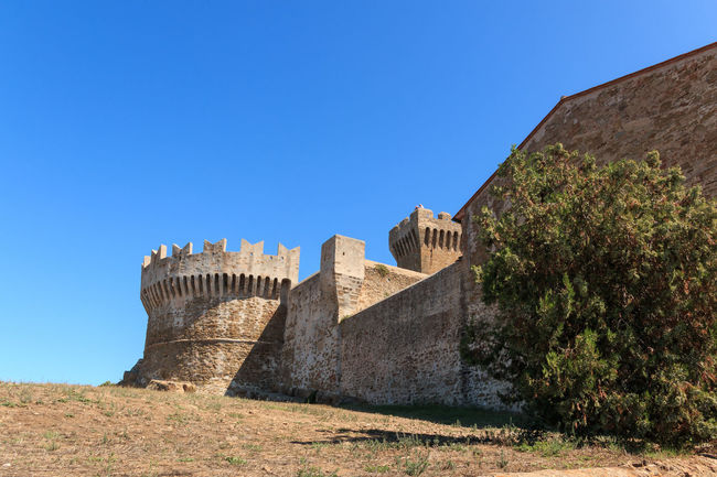 The fortress of Populonia, Tuscany, Italy Festung Populonia Ancient Ancient Civilization Architecture Building Exterior Built Structure Clear Sky Copy Space Day Fort Fortified Wall Fortness History Low Angle View Nature No People Outdoors Ruined Sky Sunlight The Past Travel Travel Destinations Wall