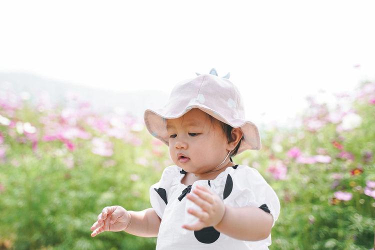 Cut girl wearing hat against sky