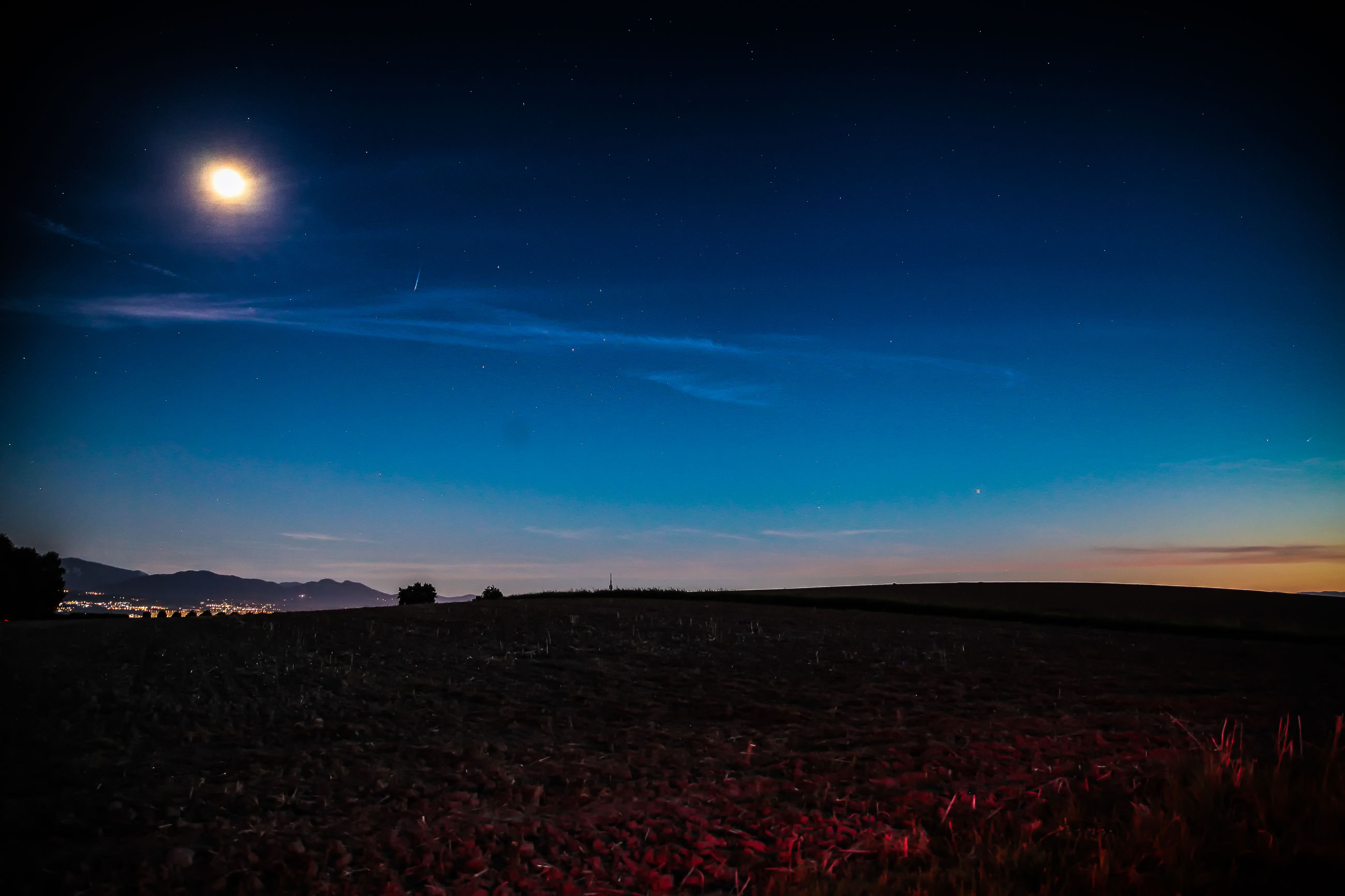 tranquil scene, scenics, night, tranquility, beauty in nature, sky, landscape, star - space, nature, moon, field, distant, cityscape, dark, blue, star, star field, glowing, outdoors, astronomy, mountain, non-urban scene, majestic, remote, mountain range, land, no people, atmosphere