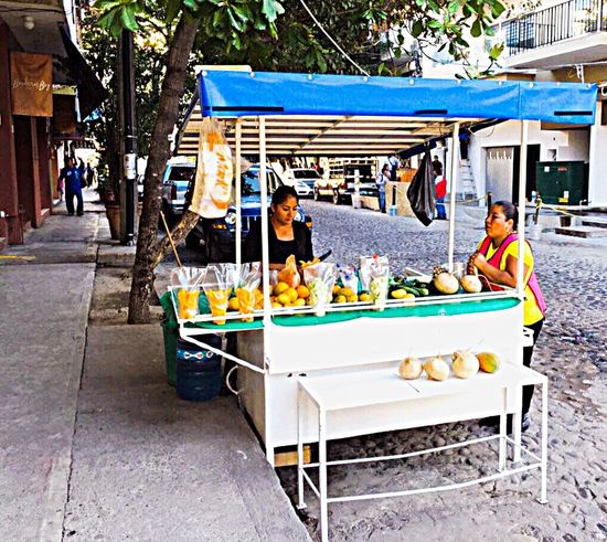 A street vendor Street Vendor Food Stand Fruits Juices People Local Street Culture Puerto Vallarta Mexico Travel Outdoors Colour Of Life Two Is Better Than One People And Places