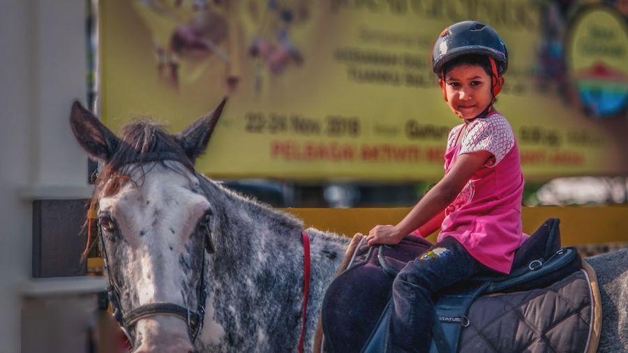 Girl riiding horse