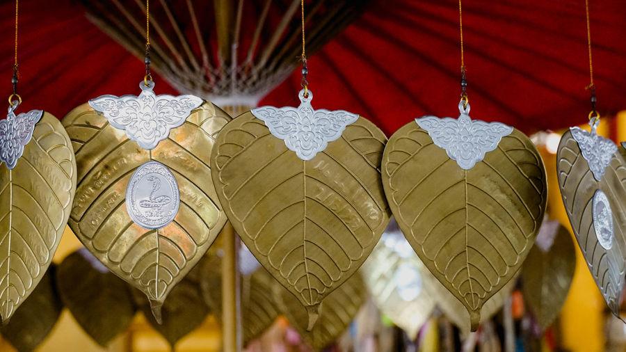 Close-up of lanterns hanging at market stall