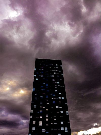 Low Angle View Building Exterior Architecture Cloud - Sky Tall - High City Cloud Built Structure Skyscraper Tower Mordor Modern Cloudy Tall Cloudscape EyeEm Gallery Check This Out Dramatic Sky Atmosphere Lagavia Colors And Paterns Madrid Halloween Mistery Misterious