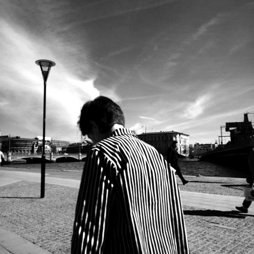 Rear View One Person Striped Adult One Man Only Young Adult One Young Man Only People Leisure Activity Sky Men Outdoors Black And White Photography Blackandwhitephotography Stockholm Sweden Streetphotography City City Life People Watching Standing Real People Human Body Part Day