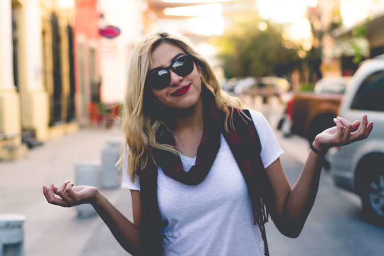 Beautiful Woman In Sunglasses Standing On Road