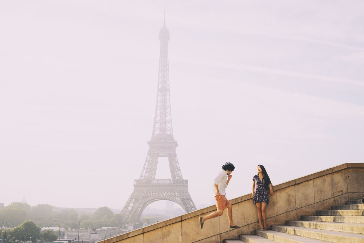 Couple in front of eiffel tower