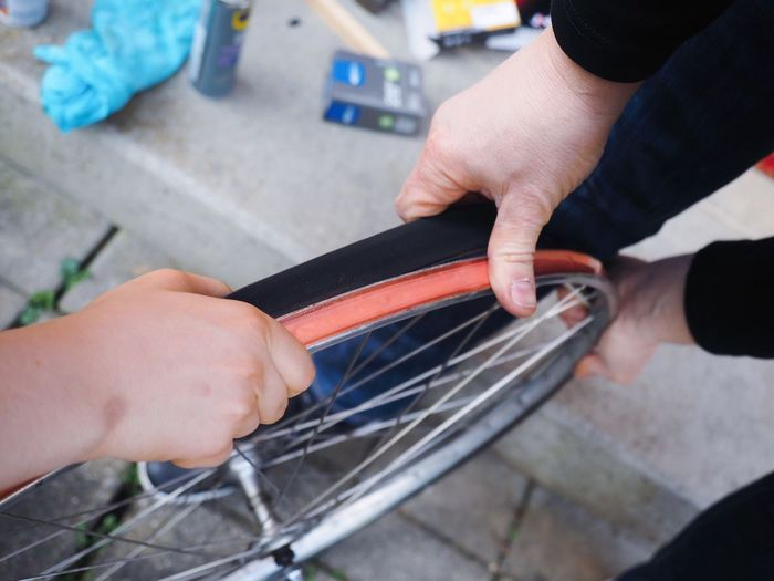 Father and son repairing a bicycle Repairs Mechanic Bicycle Tire Wheel Bicycle Human Hand Human Body Part Real People Occupation Two People Indoors  Men Working
