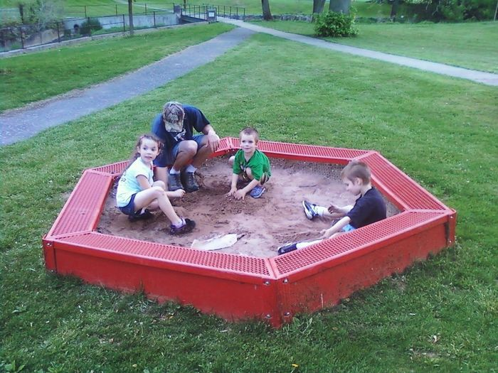 Fun with sand Togetherness Girls Boys Childhood Sitting Friendship Kids Sandbox Grass Real People Child Four People Sand Playing Building Sandcastles Brothers And Sister