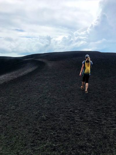 Sky Walking Full Length One Person Lifestyles Nature Backpack Rear View Landscape Day Adventure Standing Scenics Women Determination Volcanic Landscape Challenge Volcano Lava Field Nicaragua Cerro Negro Physical Geography