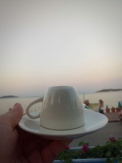 Vscocam Turkishcoffee Coffee Heaven Blue Beauty Summer Garden Beauty In Nature Fortune Human Hand Water Sea Sunset Beach Sky Close-up Horizon Over Water Countryside Personal Perspective Seascape