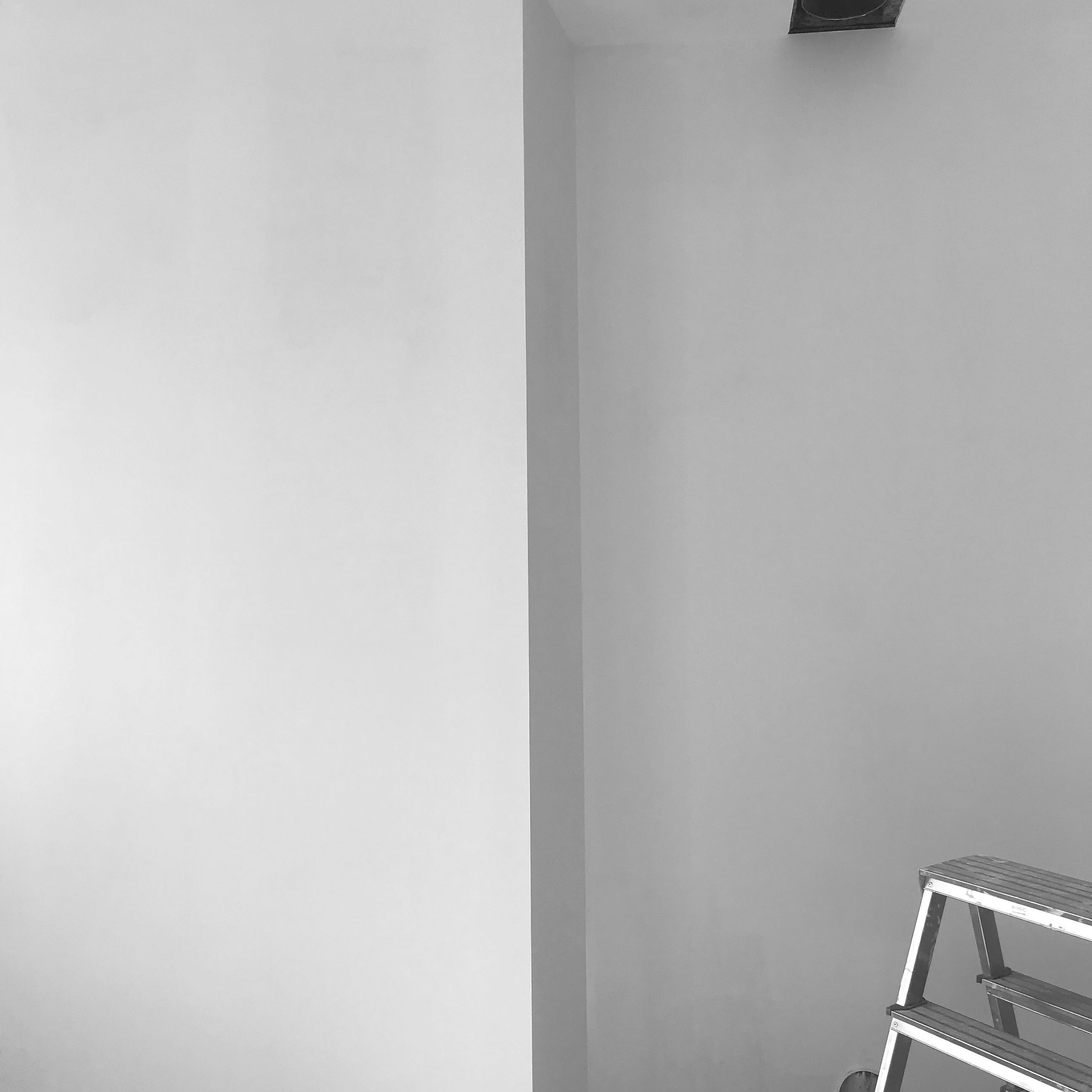 white, indoors, copy space, wall - building feature, no people, wall, architecture, house, home interior, interior design, lighting, room, furniture, built structure, black and white
