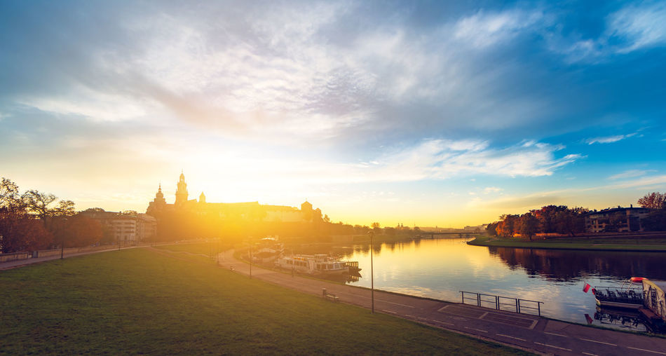 Wawel Castle by morning Krakow Poland Wawel  Panorama Panoramic Landscape Urban Skyline Sunrise Sunset Dawn Blue Sky Blue Sky Vistula River Water Reflection Sun Sunlight Castle Cloud - Sky Architecture City Beauty In Nature Scenics - Nature