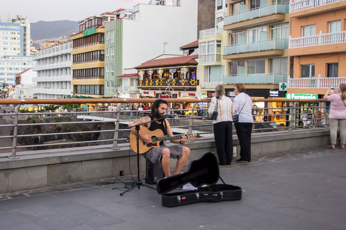 City Building Exterior Friendship Full Length Guitar Guitar Love Guitar Player Guitarist Leisure Activity Lifestyles Men Musician Musicianlife Real People Sitting Young Adult