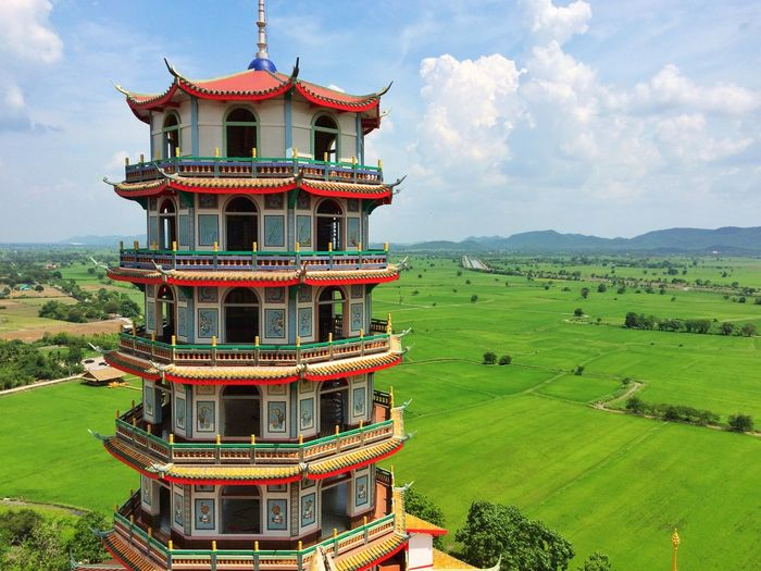 Octagon pagoda Place Of Prayer Tourist Attraction  Place Of Worship Buddhist Pagoda Buddhist Temple Culture Faith Architecture Built Structure Cloud - Sky Building Exterior Building Nature Sky Religion Day Field Outdoors Landscape Plant Land No People Beauty In Nature Green Color Travel Destinations Belief Grass