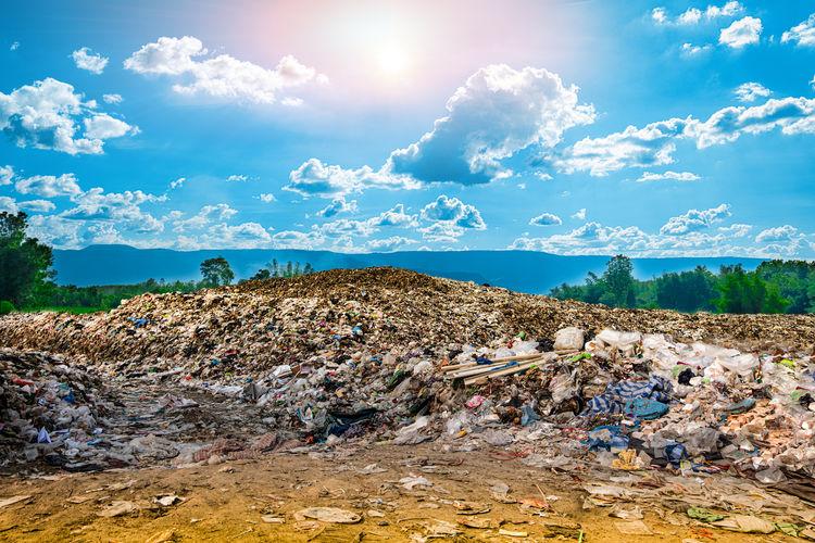 Garbage on rock against sky