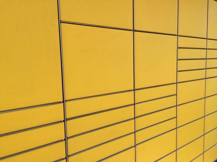 Full frame shot of yellow mailbox