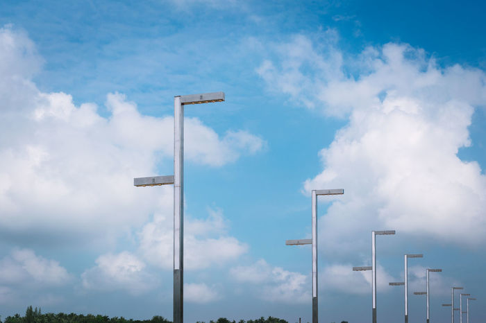 LED street lamps with energy-saving technology, cloud on sky background Air Atmosphere Backdrop Background Blue Bright Electric Electric Lamp Energy Equipment Fixture Guide High Ideas Illuminated Isolated Isolation Lamp Lamppost LED Light Message Monument New Savings Close Up Technology Minimalist Architecture