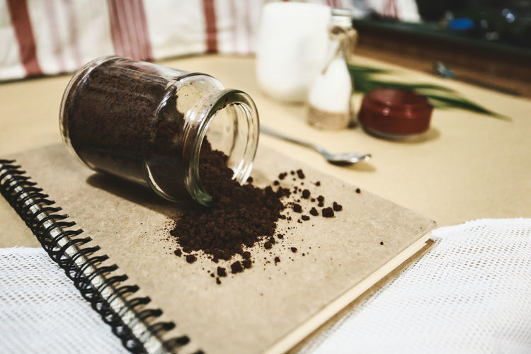 Bottle of coffee Book Brown Spoon Glass Bottle Bottle Of Coffee Bottle Glass - Material Coffee Coffee Powder Sugar Food And Drink Drinking Glass Table Ground Coffee Close-up Coffee Bean Black Coffee Beverage Iced Coffee Bottle Cap Bottle Opener