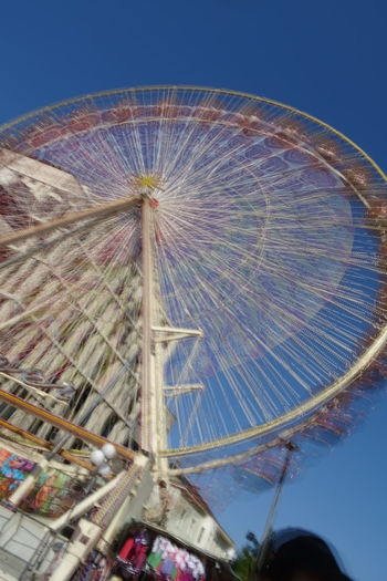 Amusement Park Arts Culture And Entertainment Ferris Wheel Amusement Park Ride Blue Sky Clear Sky Low Angle View Outdoors No People Observation Wheel Ferris Wheel Summer Architectural Detail Breathing Space Investing In Quality Of Life The Week On EyeEm #urbanana: The Urban Playground