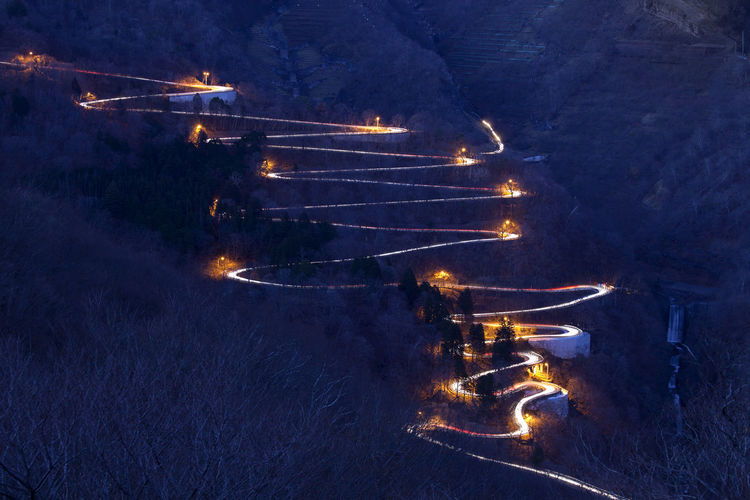 Illuminated Winding Road At Night