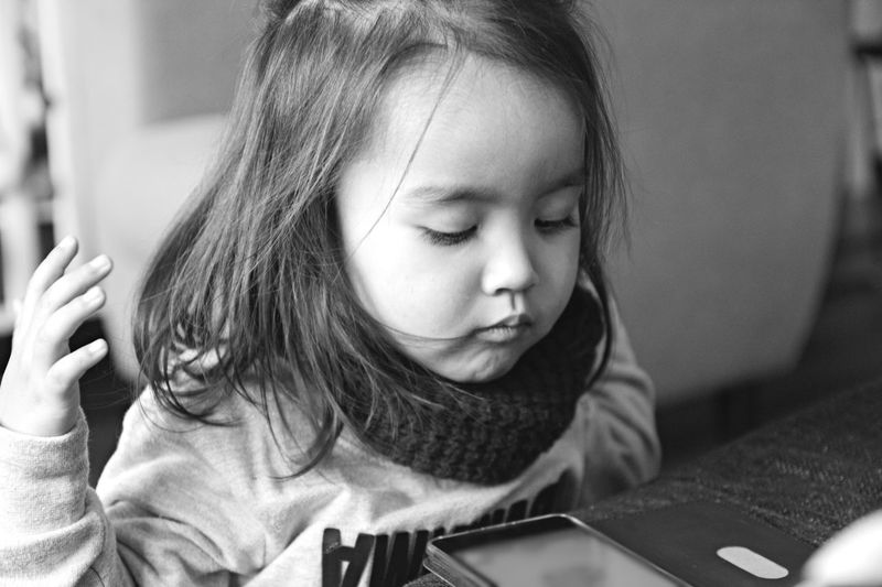 EyeEm Best Shots - Black + White EyeEm Best Shots Children Portrait Light And Shadow Bw_collection Blackandwhite Monochrome Child Childhood Wireless Technology Girls Headshot Learning Elementary Age Playing Close-up Cellphone Touch Screen Leisure Screen Device Screen Caucasian Mobile App Interactivity My Best Photo