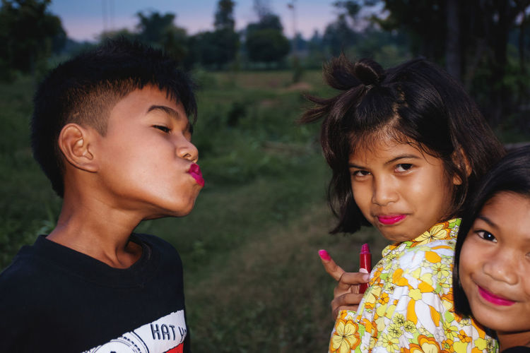 Girls and boy with lipstick