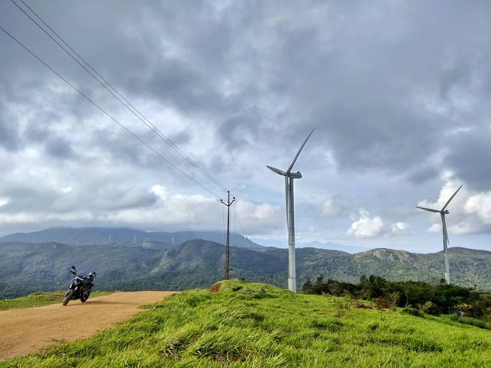 Solo rider Electricity  Cable Cloud - Sky Technology Fuel And Power Generation Windmill Bike Travel Kerala India Biker Social Issues Power Supply Power Line  Electricity Pylon Nature Sky No People Storm Cloud Outdoors Day Telephone Line Ramakalmedu