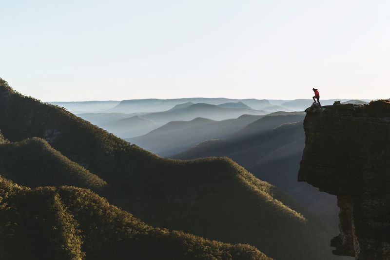 Distant person on top of a mountain
