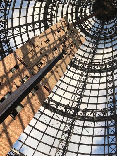 Taking Photos Building Architecture Low Angle View EyeEm EyeEm Gallery Eye4photography  Abstract Pattern Circle Shape Grid Tower Shot Tower Melbourne Architecture Pattern Metal Built Structure Low Angle View Day Sunlight Outdoors Shadow Ceiling Security Directly Below Barrier Design Sky