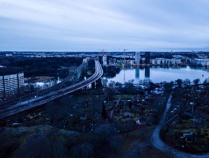 DJI X Eyeem Liljeholmen Tantolunden Aerial View Architecture Bridge - Man Made Structure Building Exterior Built Structure City Cityscape Connection Drone Photography High Angle View Lake Nature No People Outdoors Sky Skyscraper Transportation Urbanphotography Water Årstabron Årstaviken The Architect - 2018 EyeEm Awards