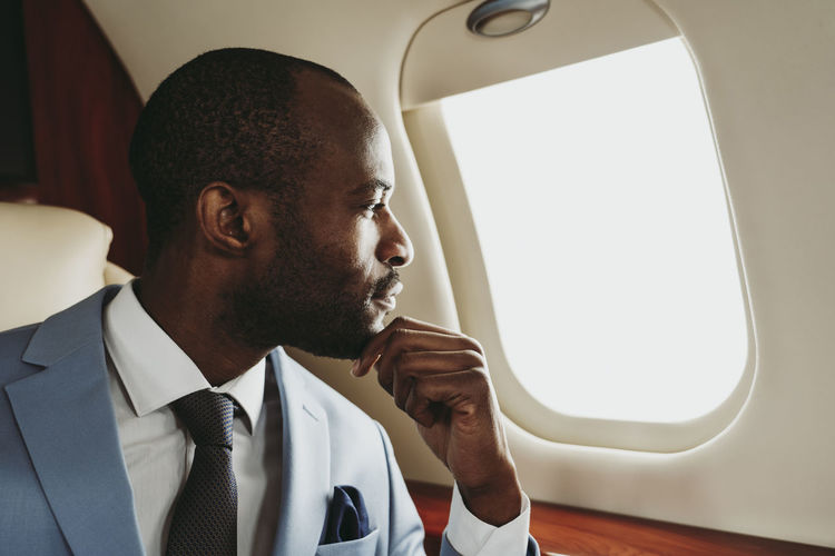 Portrait of man sitting in airplane