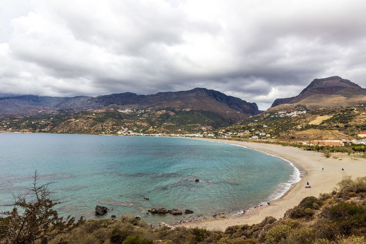 Plakias bay, south Crete, Greece Crete Greece Greece, Crete Growth Holiday Holidays Bay Beach Beauty In Nature Clear Water Clouds And Sky Crete Dune Greece Landscape Mountain Nature Plakias Sand Sand Dune Scenics Tourism Tranquility Travel Destinations Turquoise Vacations