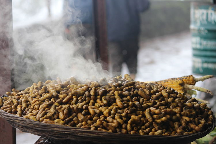 Close-Up Of Peanuts In Basket At Market For Sale
