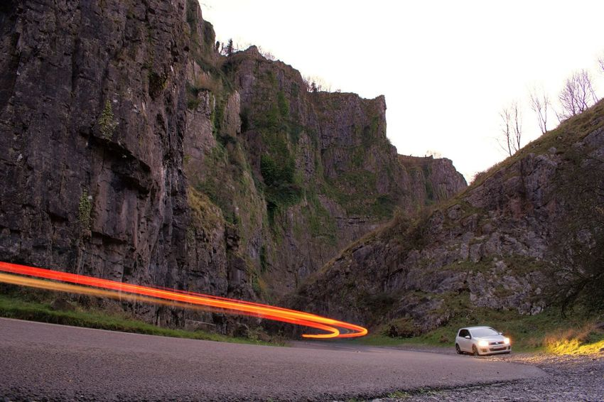 Car Road Mountain Transportation Cliff Road Trip Travel Travel Destinations Nature No People Outdoors Mountain Road Landscape Winding Road Red Adventure Mountain Range Beauty In Nature Sky Scenics Cheddar Gorge Long Exposure