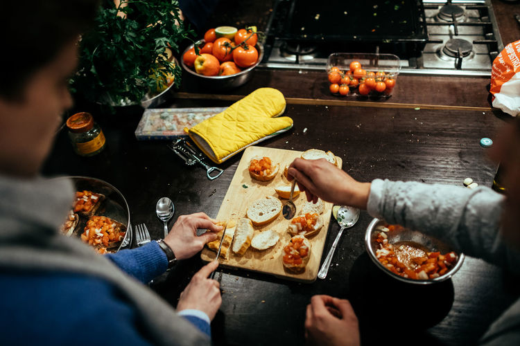 Cooking day Adult Adults Only Celebration Cooking Cooking At Home Day Eating Enjoyment Food Food And Drink Freshness Friendship Happiness Healthy Eating Leisure Activity Men Outdoors Party - Social Event People Ready-to-eat Real People Togetherness Women Young Adult Young Women