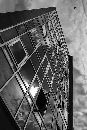 Urban Architecture Mystical Mystic Ominous Ominous Beauty Eerie Dramatic Sky Black & White Photography B & W Photography Black And White Photography Vertical Shot Berlin Urban Scene EyeEm Selects Low Angle View Cloud - Sky No People Sky Built Structure Metal Architecture Pattern Sunlight Building Exterior