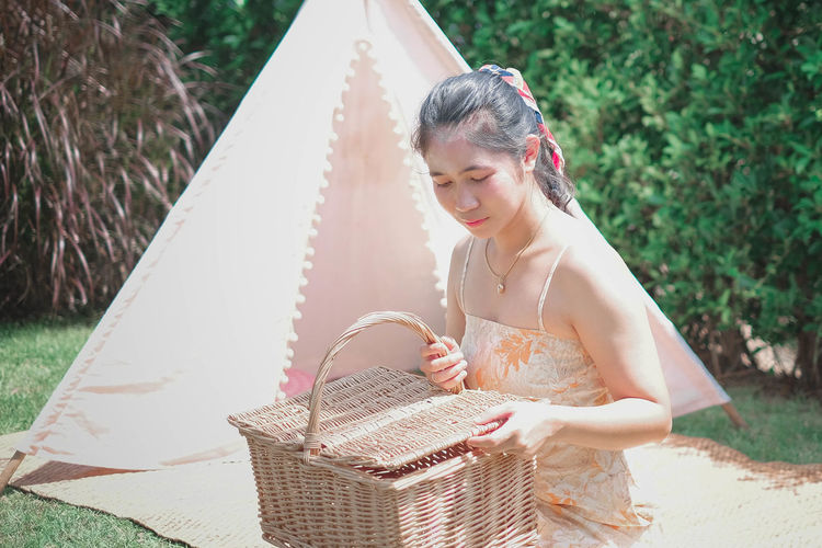 Beautiful young woman holding basket