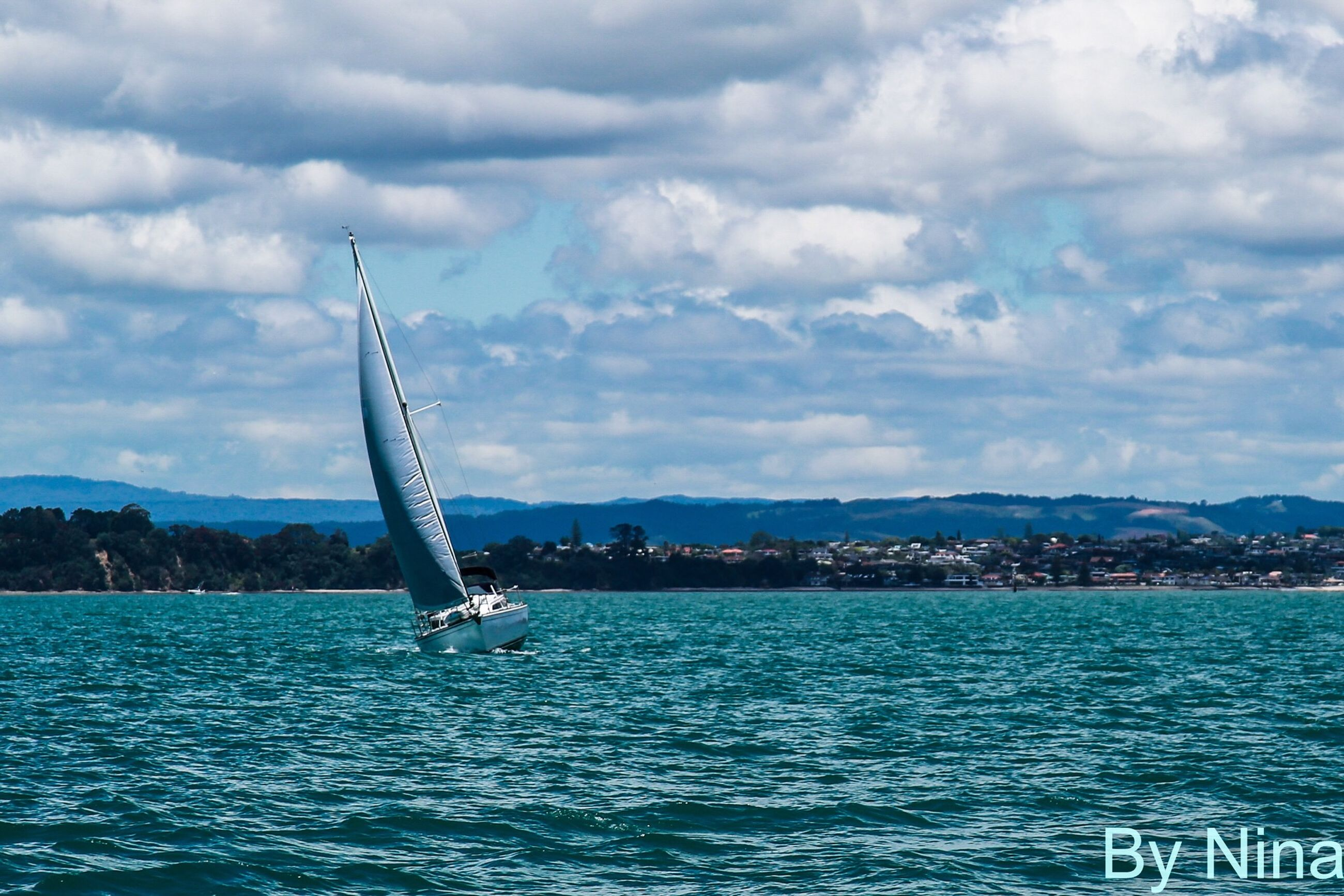 water, waterfront, sea, nautical vessel, sky, transportation, cloud - sky, mountain, mode of transport, boat, rippled, sailboat, sailing, cloud, nature, tranquility, scenics, tranquil scene, cloudy, beauty in nature