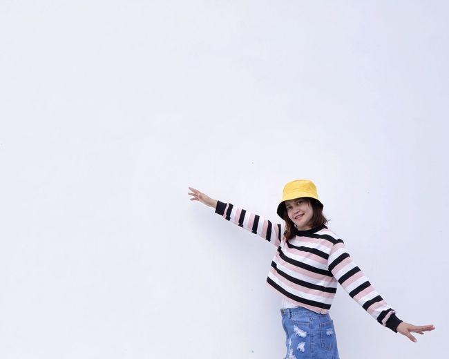 Full length of child standing against white background