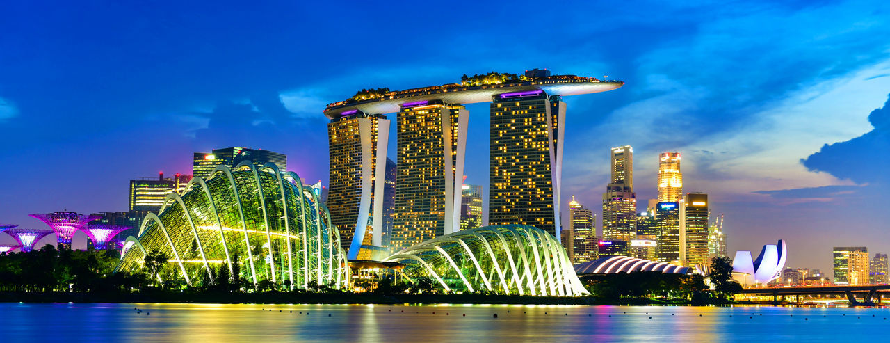 Panoramic view of Singapore skyline view of skyscrapers on Marina Bay at sunset Architecture Sky Building Exterior Built Structure Illuminated Office Building Exterior Building City Skyscraper Night Modern Travel Destinations Nature Cloud - Sky Water Urban Skyline Waterfront Cityscape No People Outdoors Financial District  Bay Singapore Marina Bay Sands Cityscape Asian  Panoramic Twilight Urban Sunset Iconic