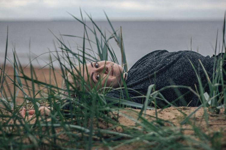 Portrait of man relaxing on beach