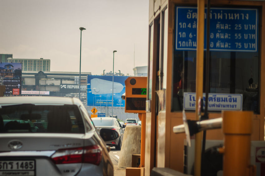 Bangkok, Thailand - May 23, 2017: The cars were queued on express way, tollway or motorway gate for pay toll fee. Gate Architecture Building Exterior Built Structure Car City Communication Day Express Way Express Ways Land Vehicle Mode Of Transportation Motor Vehicle Motor Way Motorway Motorway Driving Motorway View Motorways No People Outdoors Pay Tolls Fee Public Transportation Queued Queued For Pay Queued For Something Road Road Sign Sign Street Text Toll Toll Fee Tolls Tolls Fee Tollway Transportation Travel Western Script