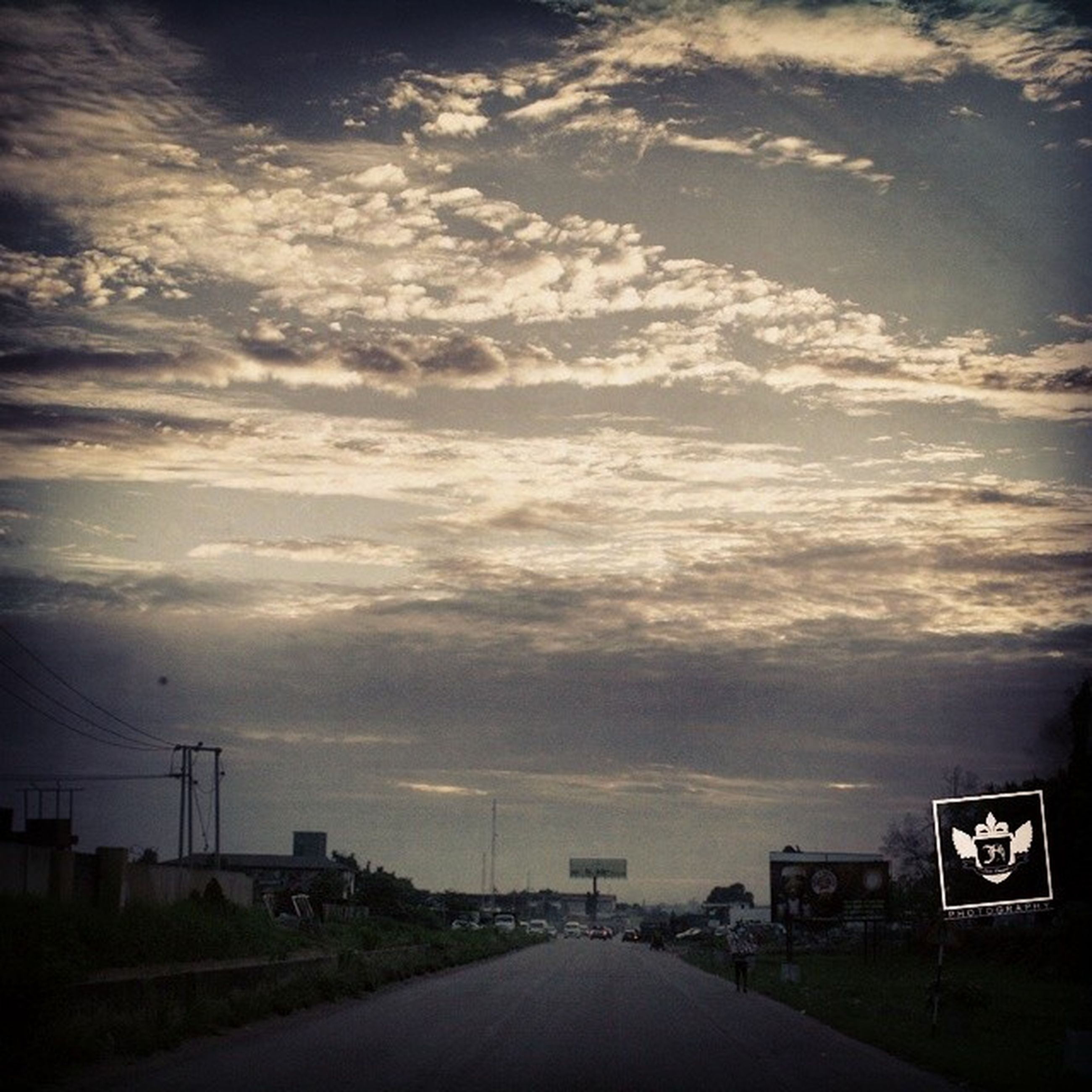 transportation, the way forward, road, sky, diminishing perspective, cloud - sky, vanishing point, street, road marking, car, sunset, country road, cloudy, land vehicle, cloud, empty road, empty, outdoors, dusk, nature