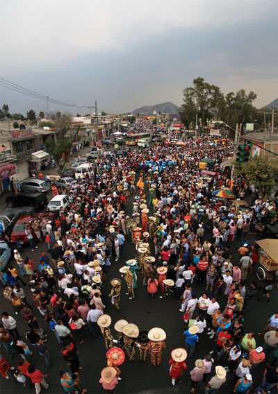 High angle view of crowd on street against sky