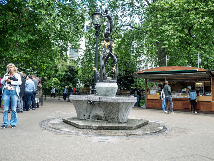 The Park Adult Architecture Building Exterior Day Drinking Fountain Fountain Full Length Large Group Of People Leisure Activity Lifestyles Men Motion Nature Outdoors People Real People Sculpture Spraying St James Park London  Standing Statue Tree Water Women