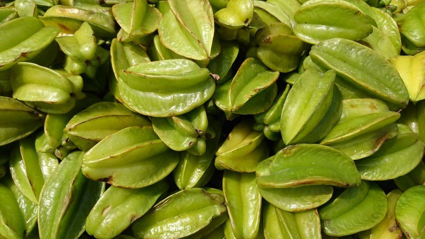 """Star Fruit scientifically """"Averrhoa Carambola"""" at Public Market, Guntur Green Color Growth Full Frame Backgrounds No People Close-up Nature Freshness Beauty In Nature Outdoors Day Star Fruit  AverrhoaCarambola Seasonal Fruit Green Fruit Close-up Public Market Guntur EyeEmNewHere Xperian Photography Sony Xperia Sony Xperia Xz Sony Xperia Photography."""