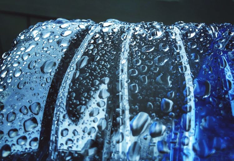 Close-up of water drops on metal